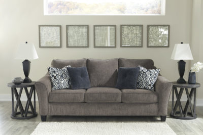 Room picture of the Nemoli Sofa sets the scene for a modern space full of casual flair with its flared arms. Its textured chenille with solid microfiber upholstery provides a luxuriously soft feel that's inviting.