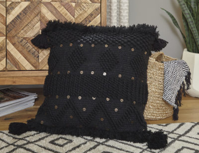 A1000934 Mordechai Pillow Room picture of a textured black ground is highlighted with goldtone accents and tassels on each corner of the pillow.